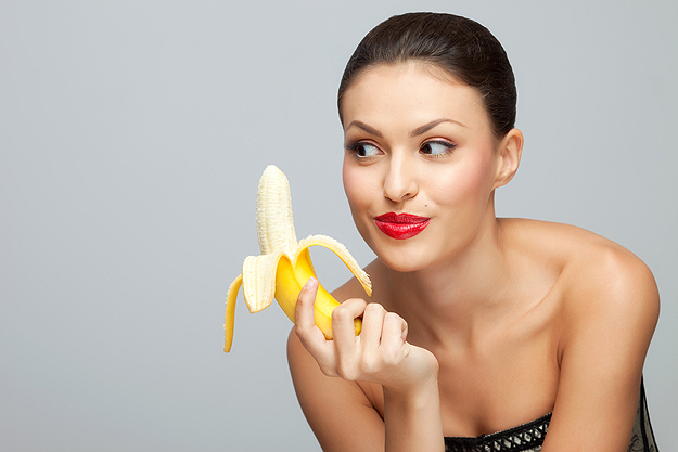 Woman-Looking-At-A-Banana