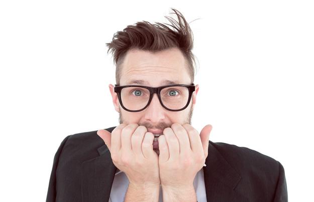 bigstock-Geeky-nervous-businessman-look-68119141