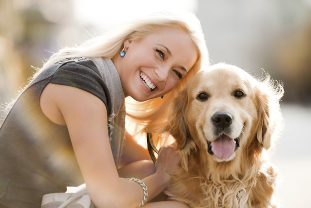 Smiling blonde female and her dog.